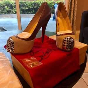Christian Louboutin brown leather heels.